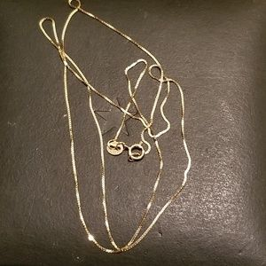14k solid yellow gold chain 20 inches length.